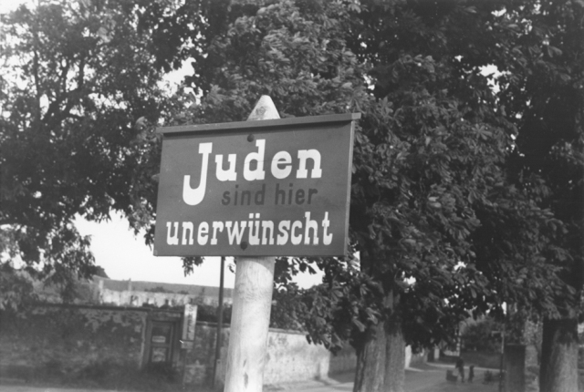 "An anti-Jewish sign posted on a street in Bavaria reads ""Jews are not wanted here."" Germany, 1937 - USHMM"